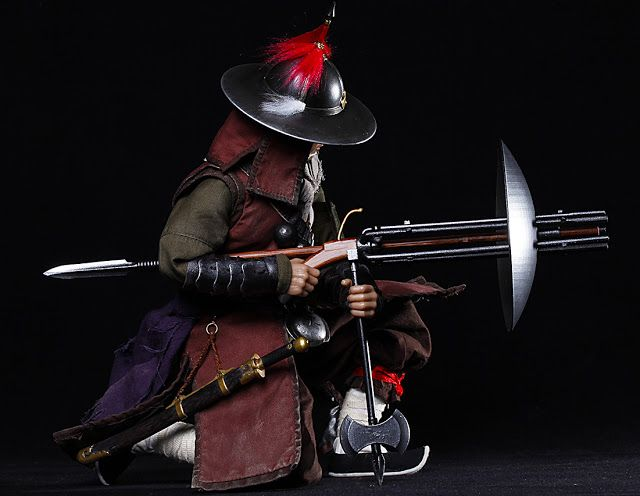 """Ming volley gunner armed with a 迅雷銃 rapid thunder bolt gun. The elite Shenjiying 神机营, or """"Divine Machine Division,"""" alternatively """"God Machine Camp"""" was one of the three elite military divisions of the Ming Dynasty stationed around the imperial capital at Beijing. Its name has been variously translated as Firearms Division, Artillery Camp, or Firearm Brigade."""