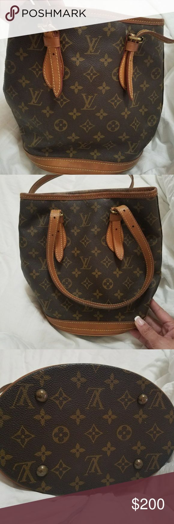 Authentic LV Petite Bucket Bag Bought this from a PF but too small for me so I'm reselling it.  Canvas in excellent condition.  The inside is peeling and has some stickiness inside.  There are tutorials online to remove this. A needle size white speck on the bottom and a small amount around bottom. Please see pics. Not noticeable... priced to sell.  Measures 10 x 10.  Inside top edges show discoloration due to the peeling and the zippers inside are discolored as well.  Good Condition. Louis…