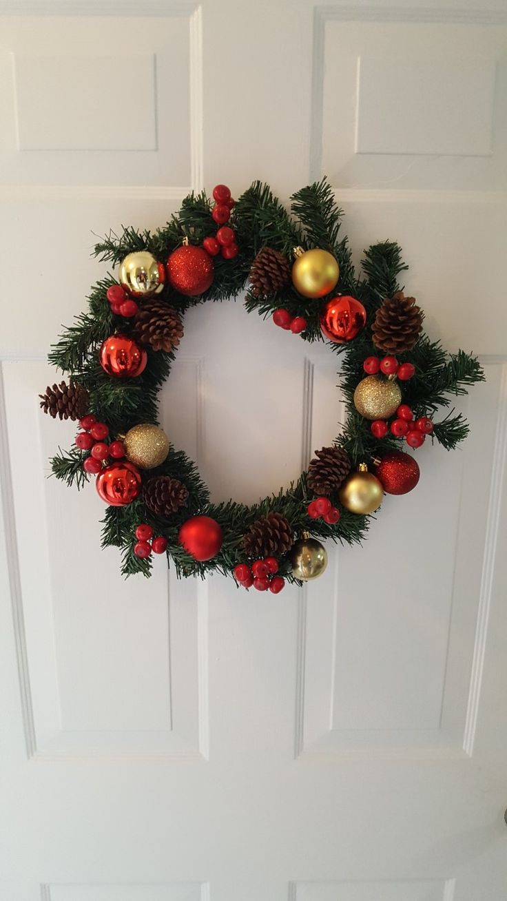 DIY Christmas wreath - plain wreath, gold and red Christmas balls from Dollarama dollar store. Red berries and pinecones from any craft store. You can add any colors or anything else for your wreath! Just have fun!