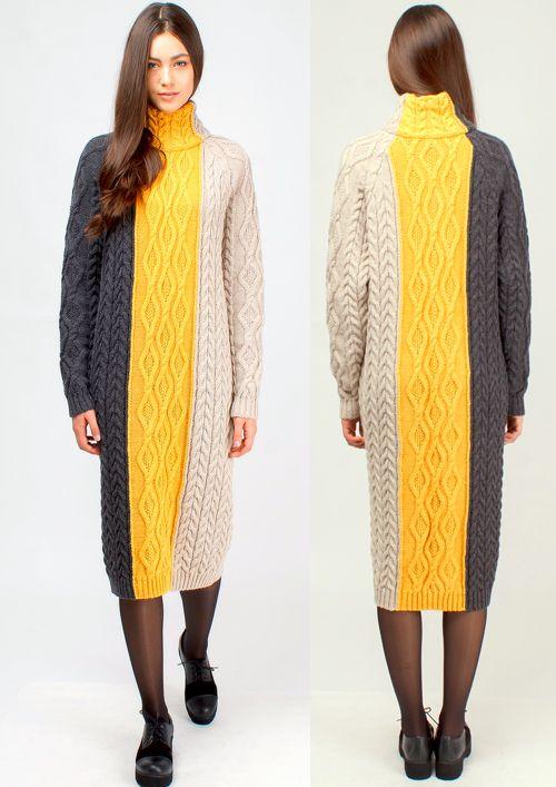 Вязаное платье-свитер очень модное в этом сезоне. Выполнено из полушерстяной нити в виде комбинации нескольких видов рельефного узора. Воротник платья – большой, двойной, выполнен крупной рельефной вязкой, рукав – реглан, красиво подчеркивает линию плеча. Основной акцент платья сделан на дизайн из цветных полос, визуально разделяющих его на три части. Платье теплое, подойдет для зимнего сезона, комбинируется с плотными колготами, леггинсами или узкими брюками.