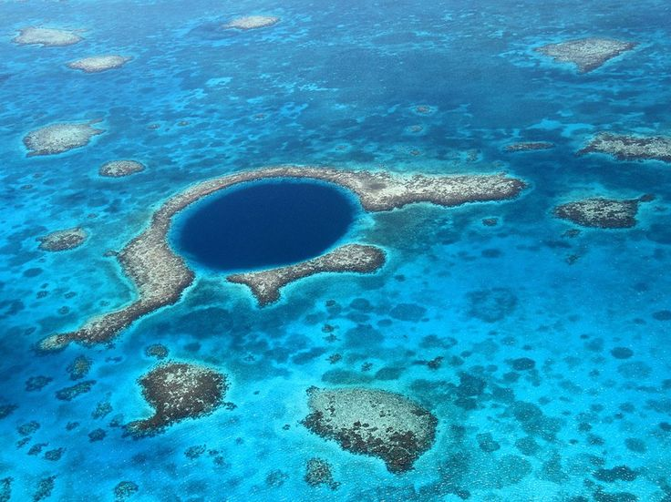 BelizeLocated about 60 miles off the coast of Belize, the Lighthouse Reef boasts beautiful coral and shallow turquoise waters…oh, and a vertical drop that's more than 400 feet deep. Meet the Great Blue Hole, a 1,000-foot-wide, perfectly circular sinkhole in the middle of the atoll. The spot was made famous by Jacques Cousteau in 1971 when he declared it one of the ten best diving sites on the planet. He also investigated the hole and discovered it had formed as a limestone cave during the…