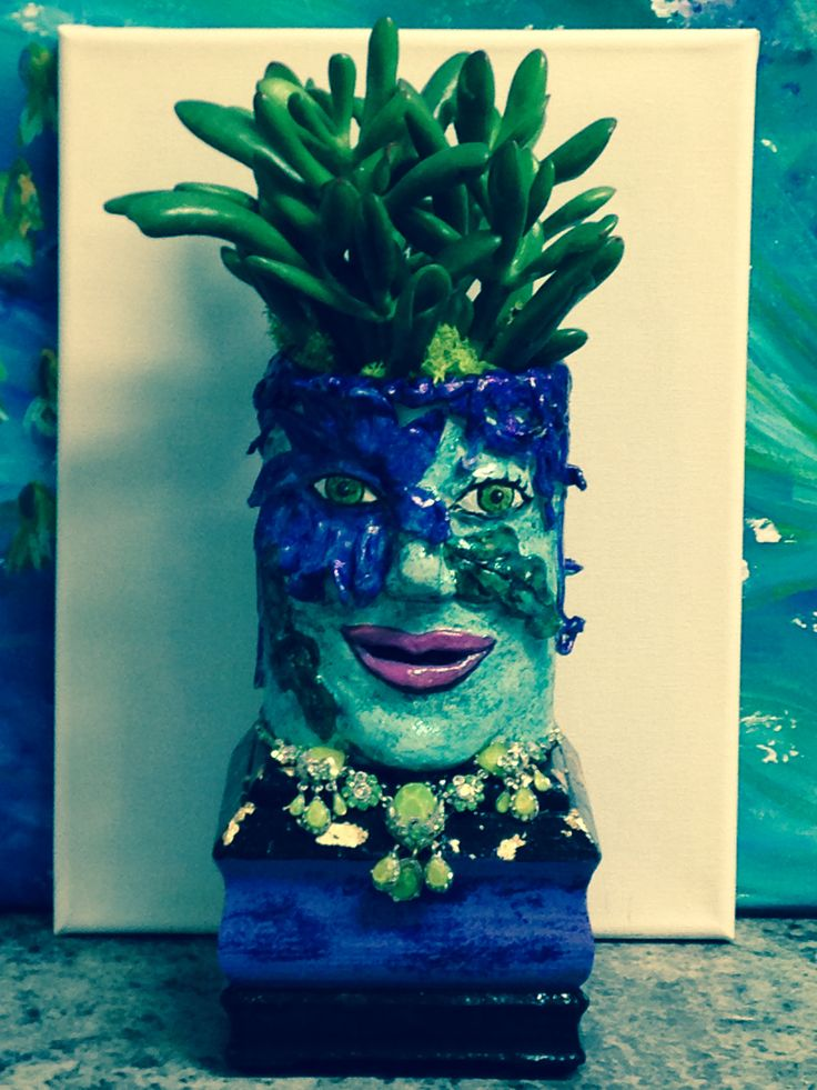 I have a fascination with succulents and decided to create some face containers sporting fancy hairdos.  This one will be on sale at the Belleville Art Association in Nov. 2016