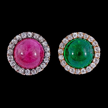 A pair of cabochon cut ruby, emerald and antique cut diamond earrings.