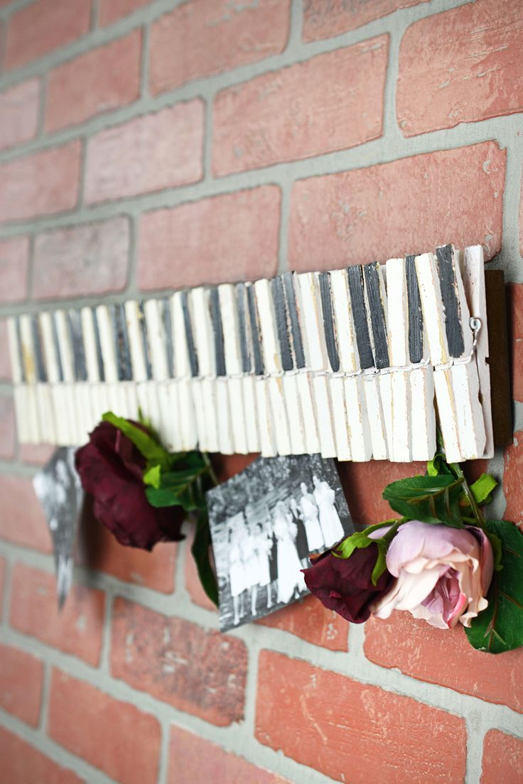 "save-on-crafts.com...$24.00...22"" Wood Clothespin Piano Key Photo & Card Holder  What a wonderful way to see all your cards, photos and notes. It is made with painted clothespins and has two slots on the back for hanging. It is 22"" long x 4"" wide. Could use to hold escort cards at a Jazzy event.  $24.00"