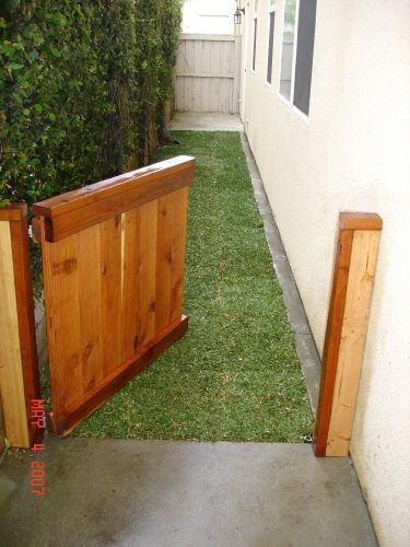 Dog run - I love this idea!! I think we will do this down the side of the yard. No more puppy poop!!!
