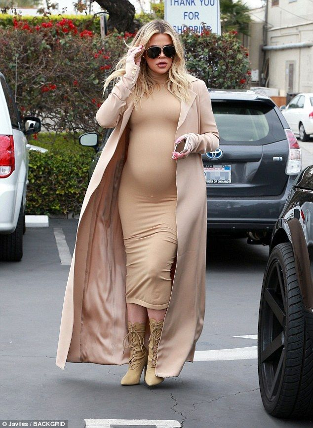 Glowing mama-to-be: Khloe Kardashian showed off her growing baby bump in a skintight tan dress for baby clothes shopping with mom Kris Jenner on Wednesday