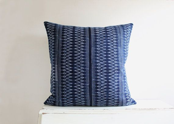 A beautiful cushion cover created by piecing together two panels of a Hmong textile. The front is dark indigo blue with a geometric pattern