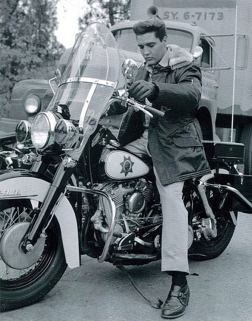 Elvis trying a bike