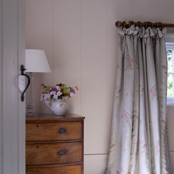 'Pale Sienna' paint pairs wonderfully with the hand printed pink rose linen fabric in this peaceful bedroom. #susiewatson #susiewatsondesigns
