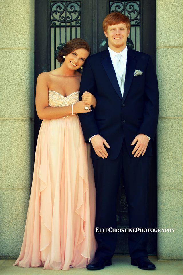 cute grad pose; but have the man's right arm on his stomach and his left arm completely by his side. like he's escorting her