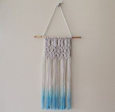 How to tie a double half hitch knot and create a small macrame wall hanging with detailed instructions, illustrated steps, and plenty of photos for beginners.