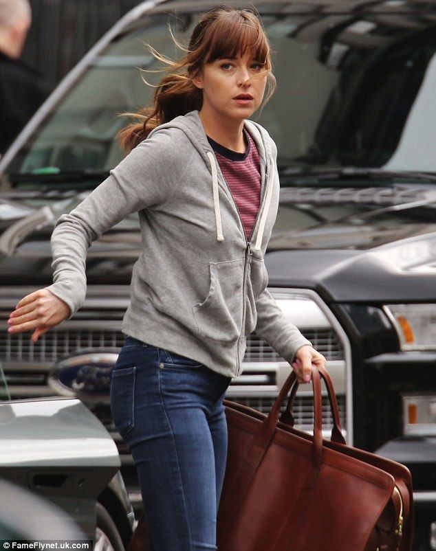 On the move: The 26-year-old donned a striped red and blue shirt and a grey zippered hoodie while in character as Anastasia Steele