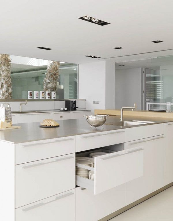 like the white kitchen and island with a sink and draws