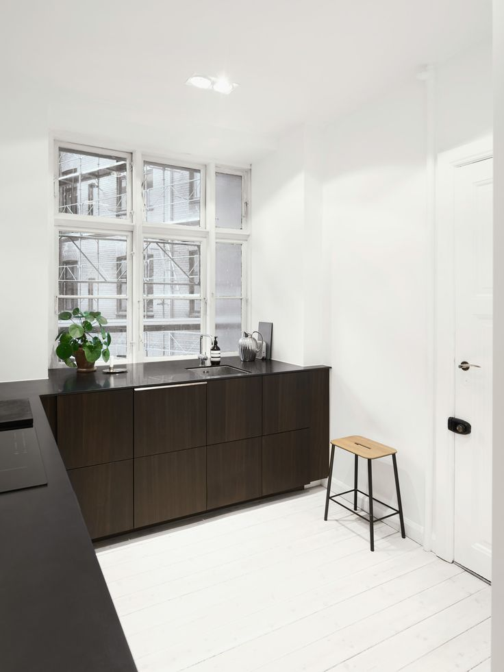 A creative couple in Copenhagen have a Reform Norm Architects' kitchen design in their bright apartment.