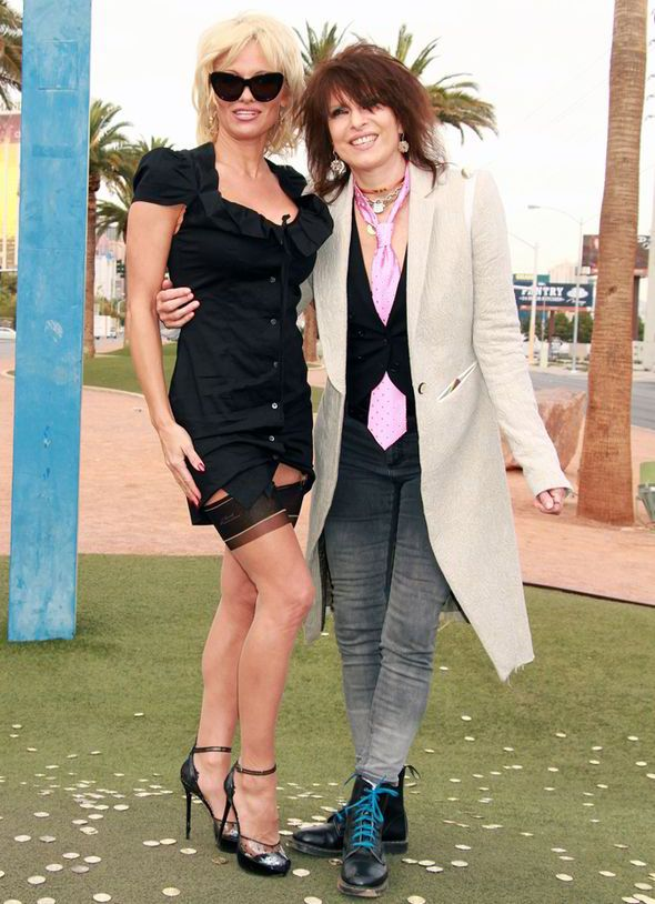 Less Than Traditional Pamela Anderson Wears Stockings And Suspenders To Friend S