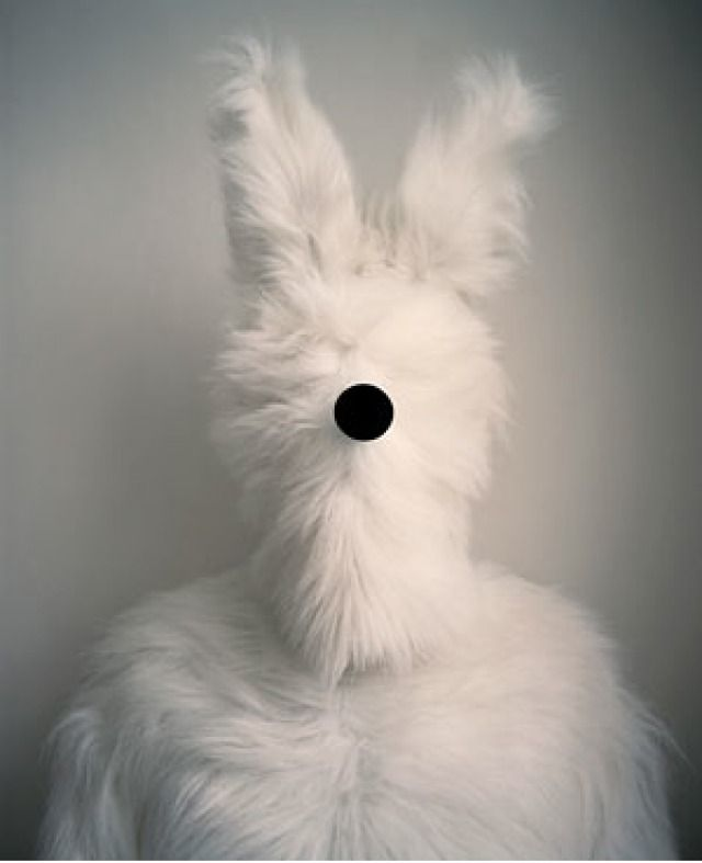 It took me awhile to figure out that this is a new variety of scary bunny..Oviously an inter-galatic bunny with a black hole sucking capability that can turn the universe inside out..yep..that's it..   by polly borland: Rabbit Costume, Faces, White Bunnies, Borland Rabbit, Polly Borland, Posts, Heart Bunnies, Bunnies Stuff, Peggi Borland