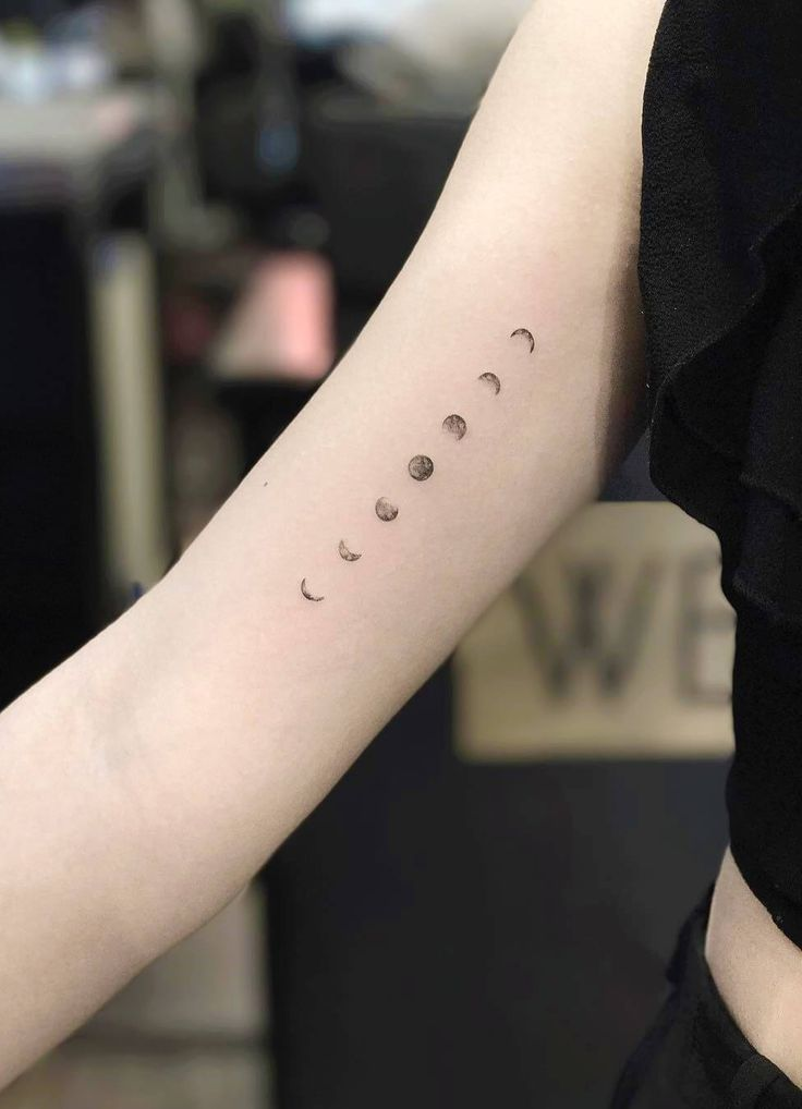 Phases of the moon tattoo thigh