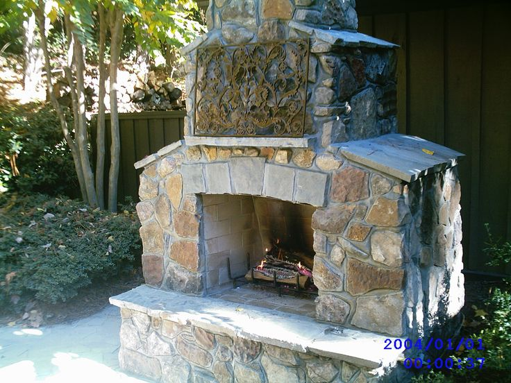 17 best images about outdoor fireplaces on pinterest for Wood stove insert for prefab fireplace