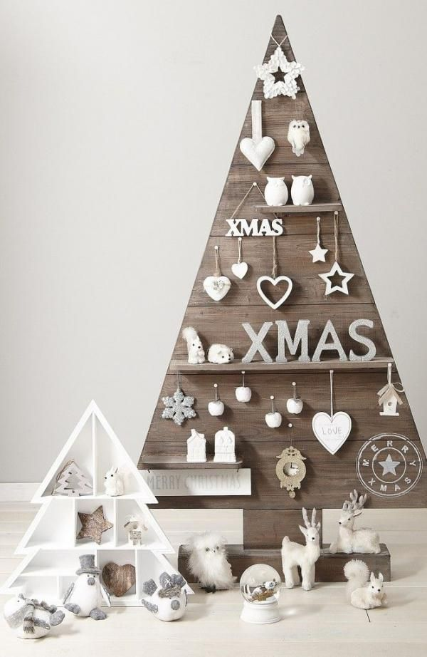 Wooden board Christmas tree adorned with ornaments. Be artistic and set up your own wooden board in a Christmas tree silhouette. Add cute and adorable ornaments to enhance the décor.