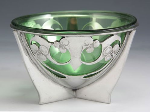 Liberty & Co - Designer - Archibald Knox - Description - Polished pewter bowl from the 'Tudric' range with green glass liner. @designerwallace