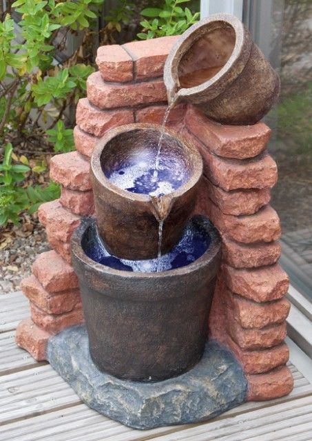 Solar Cascading Plant Pots Water Feature with LED Lights   This attractive water feature looks just like natural stone, but is in fact made from polyresin, which is durable and frost resistant. It is powered by an integral solar panel, and the LED lights further enhance its ch
