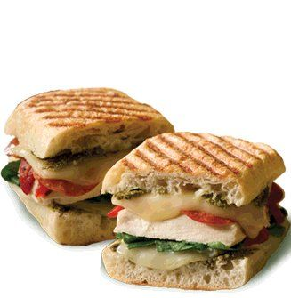 Recipe for Turkey Club Panini with Jalapeno Basil Pesto - In Italy, panino is the word for a sandwich made from bread other than sliced bread, but this Jalapeno Basil Pesto makes it a whole new sandwich!