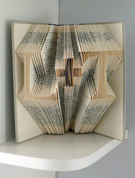 """Anniversary Gifts for Boyfriend  - Valentine's Day - Girlfriend Gift - Two initials with """"plus"""" in between - Paper Anniversary. $55.00, via Etsy. --Totally could do this with any old book. Cool idea!"""
