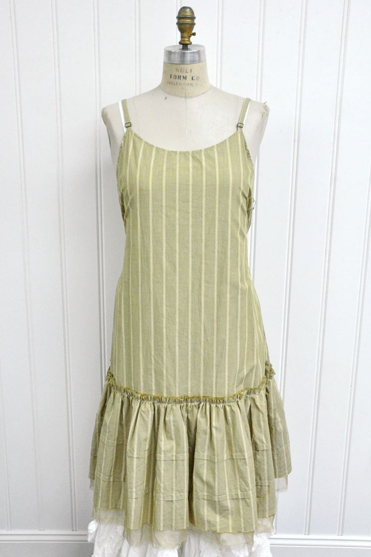 """Features Beautiful layer piece Skinny straps Double layer gathered ruffle Side ties 100% Striped Cotton Broadcloth, Tea Leaf Wide Fits sizes 2-16 Measurements: Chest: about 44"""" around Length: about 44"""" long"""