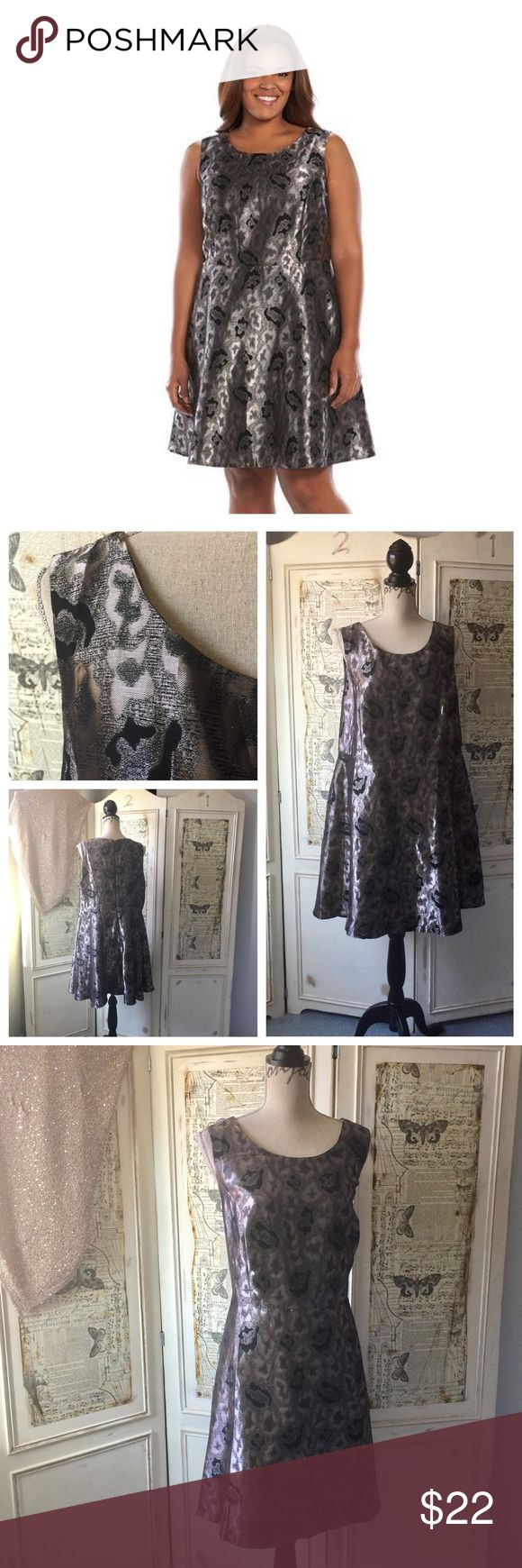 """Apt. 9  Foil Jacquard Fit & Flare Dress Sz 18W NWT Plus Size Apt. 9  Foil Jacquard Fit & Flare Dress Sz 18W NWT.  Metallic fit and flare, fully lined, back zip.  61% polyester 39% rayon. Lining 100% polyester. Measures 35"""" in length. Bust approx. 42"""", waist approx. 40"""", hips approx. 50"""".  #lisamariesvibe #apt9 #plussize #curvy #foiljacquard #metallicdress #occasion #datenight #weartowedding #18w #nwt Apt. 9 Dresses"""