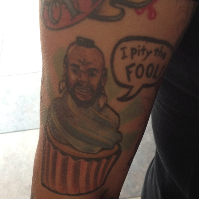 A customer has a Mr T cupcake tattoo!