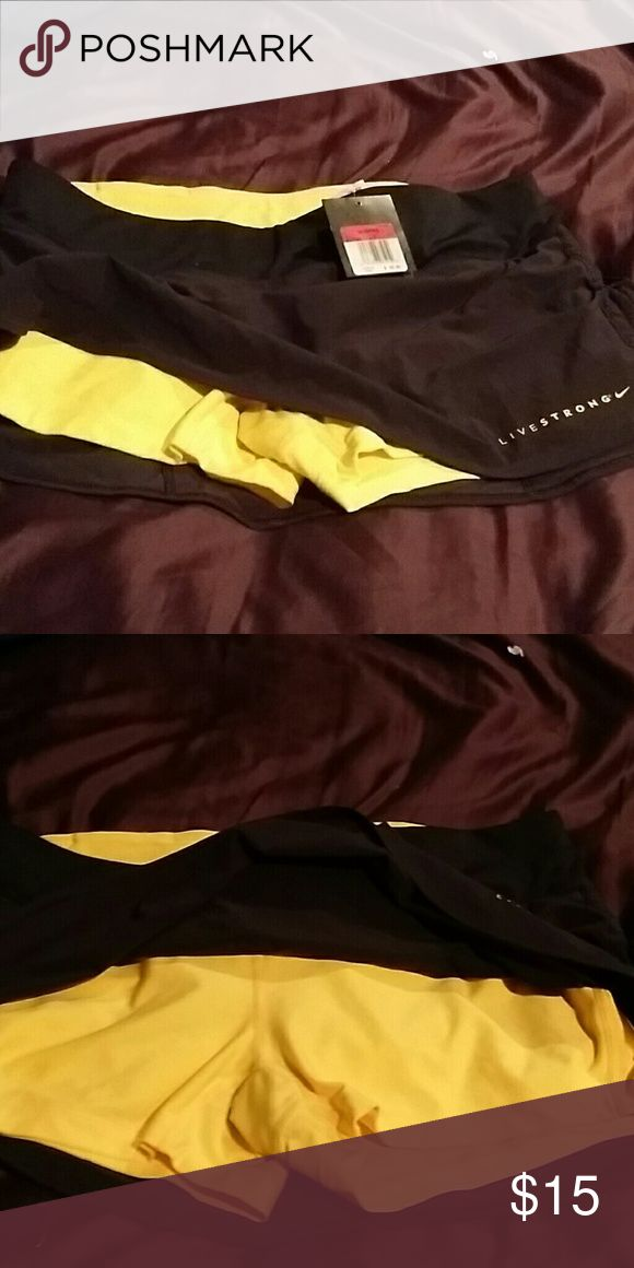 Womens Nike shorts with skirt.. Dri fit Nike shorts with attached skirt. Good as a Bathing suit, tennis shorts or running shorts..  dri fit material Nike Swim