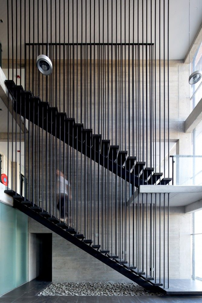 A staircase within a corporate building for Ferretería O´Higgins;   Architects: GH+A | Guillermo Hevia;   Location: Pudahuel, Santiago, Chile;