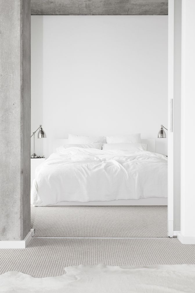 An easy room to recreate. All whitened bed on floor with simple IKEA lamps melody weir.com