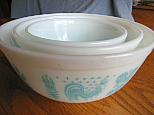 Every mom I've ever known has a set of these somewhere. Farm-themed nesting bowls in turquoise by Fire King.