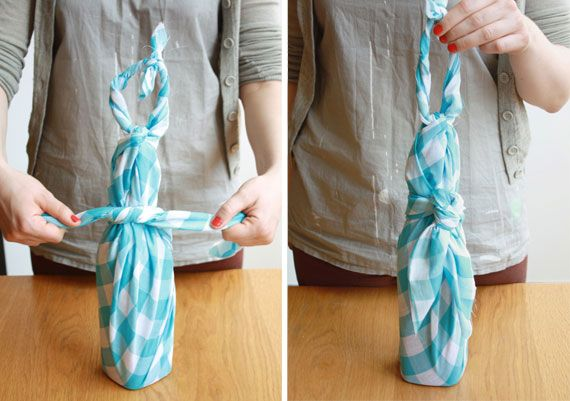 wrap a bottle with a picnic blanket/scarf, gotta do this for housewarming gifts!