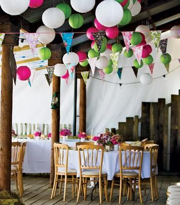 Bright coloured nylon lanterns and bunting liven up an outside space at a destination wedding.