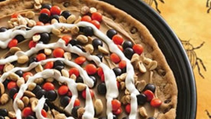 Peanutty Halloween Cookie Pizza recipe and reviews - Enjoy a wonderful dessert pizza this Halloween baked using Pillsbury Chocolate Chip Cookies, peanut butter and Betty Crocker* Creamy Deluxe* Vanilla Frosting.