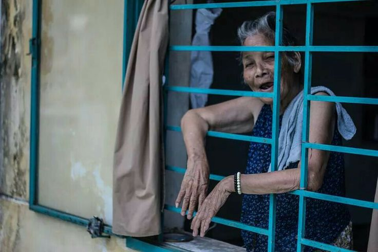 "A homeless elderly woman works in  the kitchen at the welfare center,  when shown this photo she responded in vietnames ""yes unfortunately that is me""."