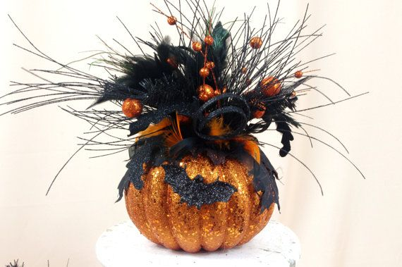 Glittered Pumpkin Arrangement * Halloween Decoration * Jack O Lantern * Pumpkin Centerpiece * Pumpkin Decor * Halloween Pumpkin * Orange  Elegant glittered pumpkin filled with sprigs, sprays, glittered leaves, ribbon, and spiders/bats.  Measures: 12 long by 12 wide (leaf span)  SHIPPING OVERAGES WILL BE REFUNDED! Feel free to convo me your zipcode for a more accurate shipping price. Each design is handcrafted! We use high quality silks and accents to make our designs elegant and unique!...