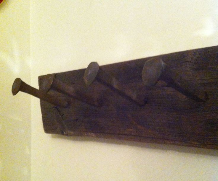 How to attach rail spikes to barn board- I'm going to make a wine glass rack for the bar with these.