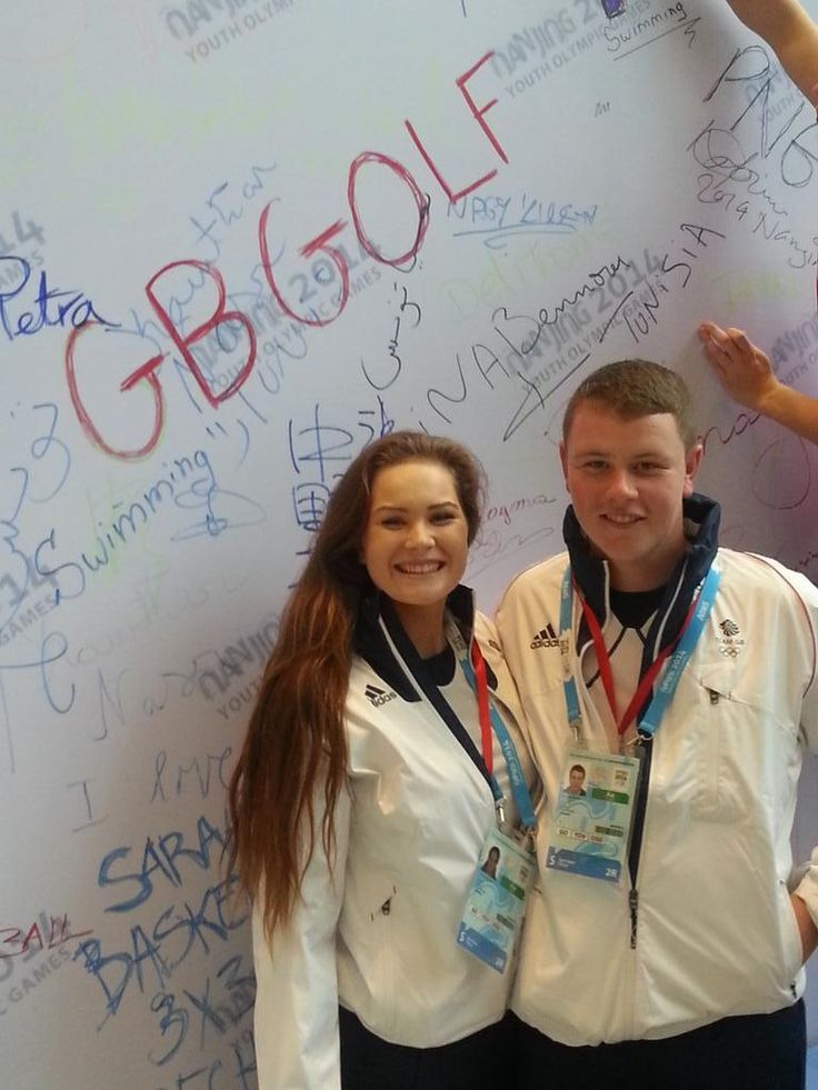 Team GB Golfers writing on the friendship wall