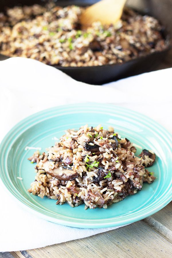Cheesy Wild Rice with Mushrooms  this is a great fall side dish full of flavor from Parmesan cheese  wild rice cooked in chicken broth and super tasty sauted mushrooms    countrysidecravings com