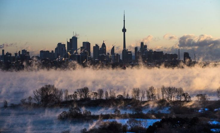 Mist rises from Lake Ontario in front of the Toronto skyline during extreme cold weather