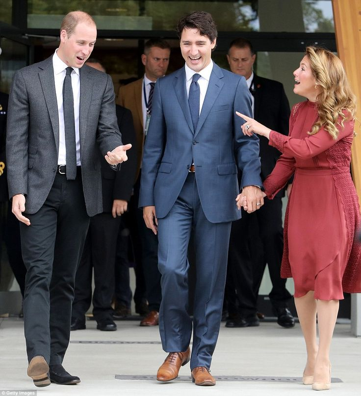 Sophie Gregoire-Trudeau, right, speaks animatedly with Prince William and her husband as they leave the centre