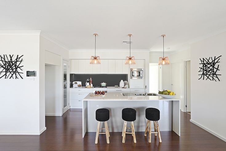 Kitchen. Chrome pendant lights. Bar stools.