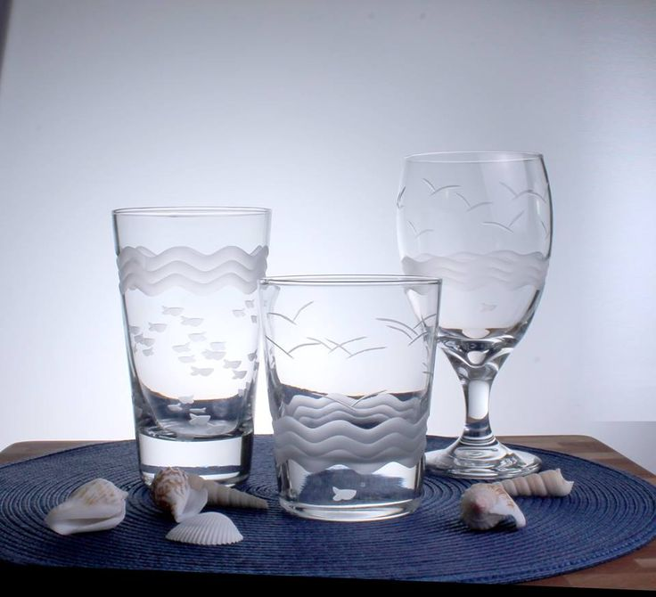 Sea Breeze Glasses with Waves, Little Fish, and Gulls: http://caronsbeachhouse.com/dining-and-entertaining/glassware-for-the-coast/etched-fish-glassware/seabreeze-dof-glasses-set-of-4.html
