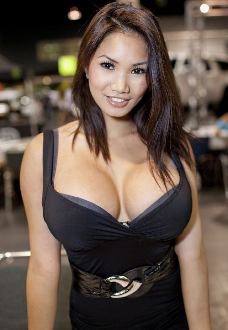 Young busty beautiful asian swimsuit model stock photo