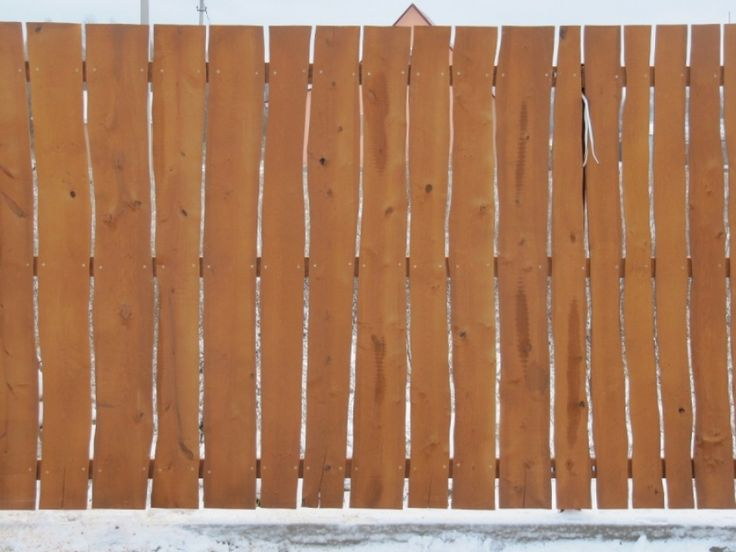 vertical fence of unedged Board with your hands