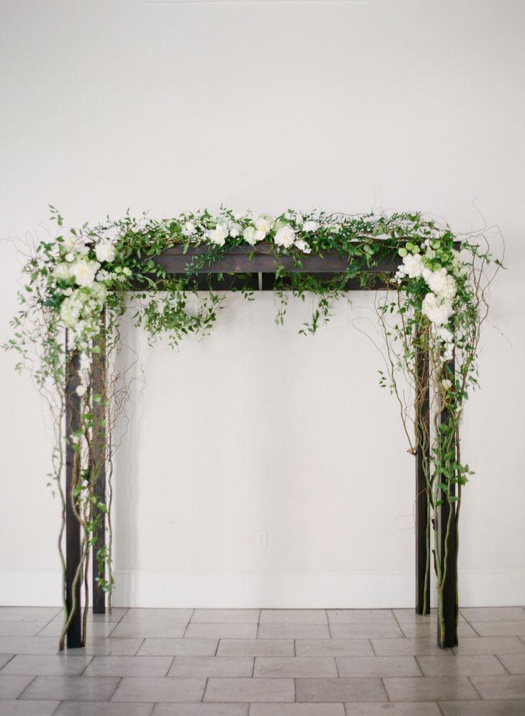 a simple ceremony arch draped in white flowers and greenery   Photography: Lauren Kinsey Fine Art Wedding Photography - laurenkinsey.com, Florals by https://myrtie-blue-kegd.squarespace.com  Read More: http://stylemepretty.com/2013/10/09/rosemary-beach-wedding-from-lauren-kinsey-2/