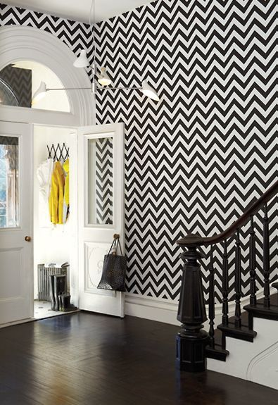 Black and white zig zag wallpaper. Love this. Needs some more bright  furniture.